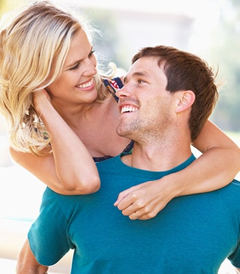 A young couple enjoying their youthful glow because of Botox treatments, available at Genesee Dental Group.