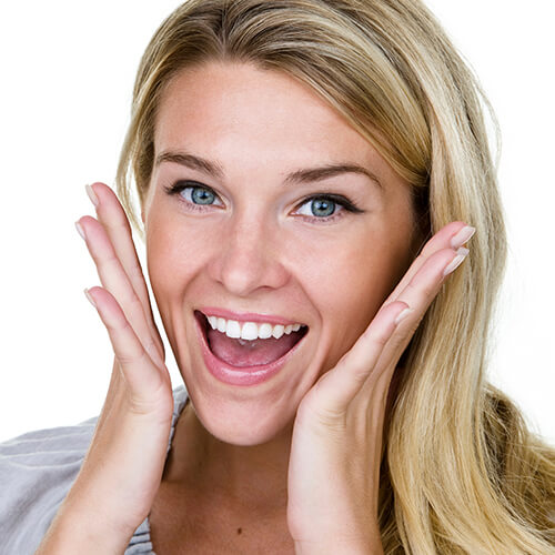Portrait of a woman's perfect smile with Invisalign